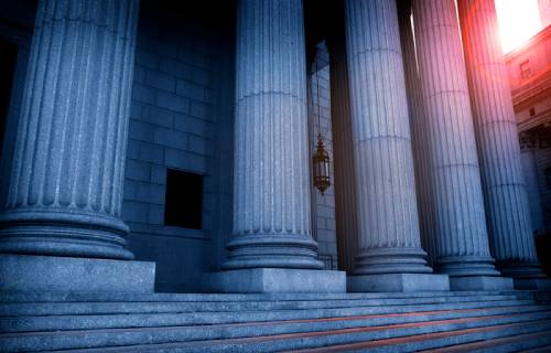 Greek-Columns-At-A-Courthouse-In-The-Late-Afternoon-image